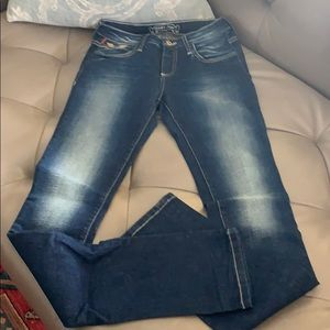 Robin's skinny distressed blue jeans gold detail